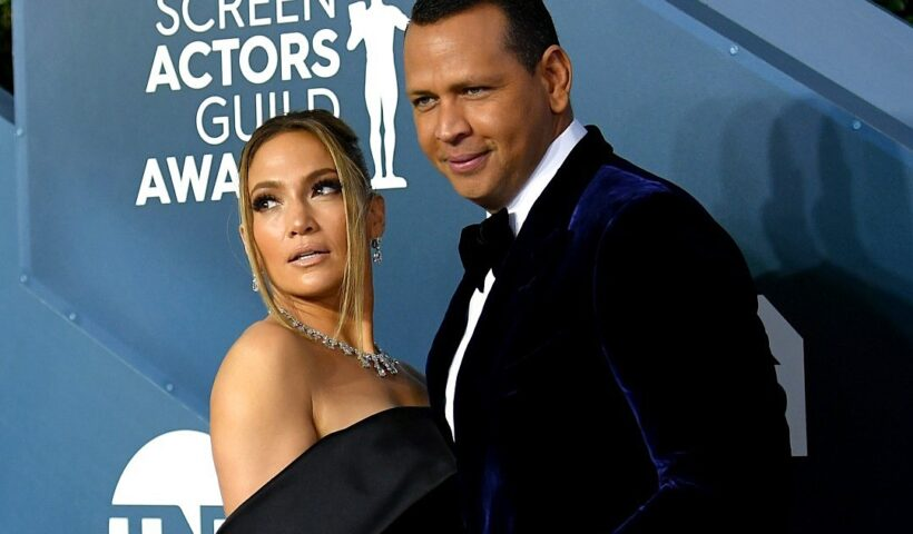 Days after rumours of their break up, Jennifer Lopez and Fiancee Alex Rodriguez were pictured kissing on a balcony.